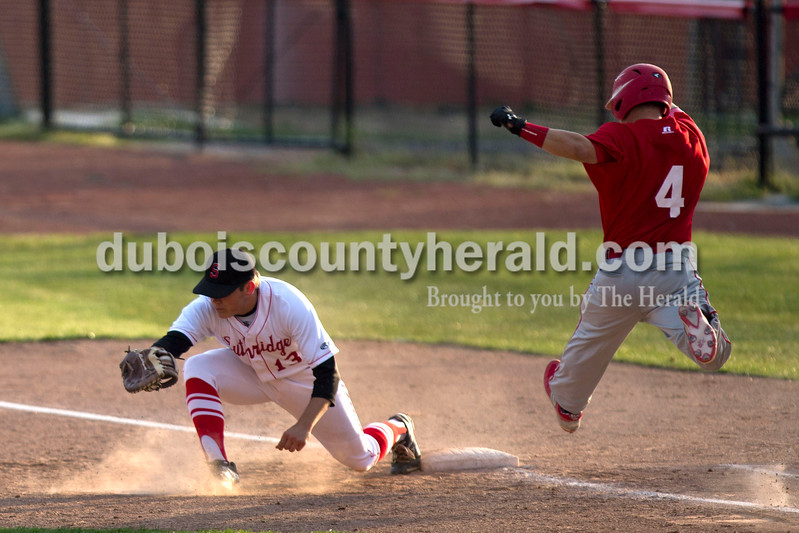 Southridge's Jacob Brewer caught the ball at first forcing out Tecumseh's Adam Lytle during Wednesday night's game against Tecumseh at League Stadium in Huntingburg. The Raiders won 6-1. <br /> Alisha Jucevic/The Herald