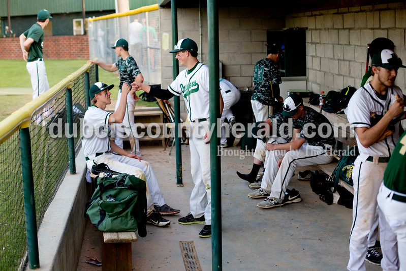 Forest Park's Damon Wilmes, left, and Jaxon Cronin fist-bumped in the dugout after Friday evening's game against Gibson Southern in Ferdinand. The Rangers won 12-2 in six innings. Ariana van den Akker/The Herald