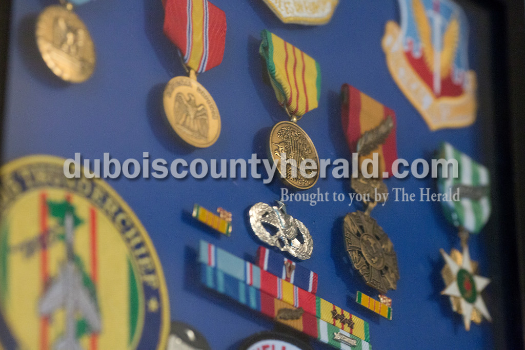 Rachel Mummey/The Herald<br /> Vietnam veteran Patrick O'Keefe kept medals from his service in a display at his Jasper home Wednesday evening. O'Keefe served as a Sergeant in the United States Air Force and was stationed in Korat Royal Thai Air Force Base in Thailand from 1968-1969. O'Keefe said he found it gratifying to listen to comrades in Vietnam who heard F-4 and F-105 fighter jets fly overhead, letting them know there was support coming in.