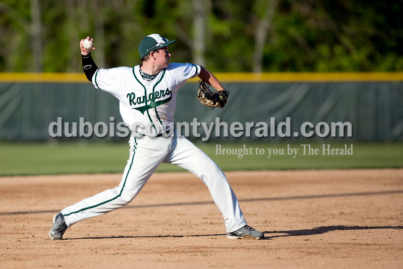 Forest Park's Trevor Zink threw a grounder to try to force an out during Friday evening's game against Gibson Southern in Ferdinand. The Rangers won 12-2 in six innings. Ariana van den Akker/The Herald