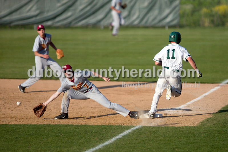 Forest Park's Eli Knust was safe on first as Gibson Southern's Jesse Reed reached for the ball during Friday evening's game in Ferdinand. The Rangers won 12-2 in six innings. Ariana van den Akker/The Herald