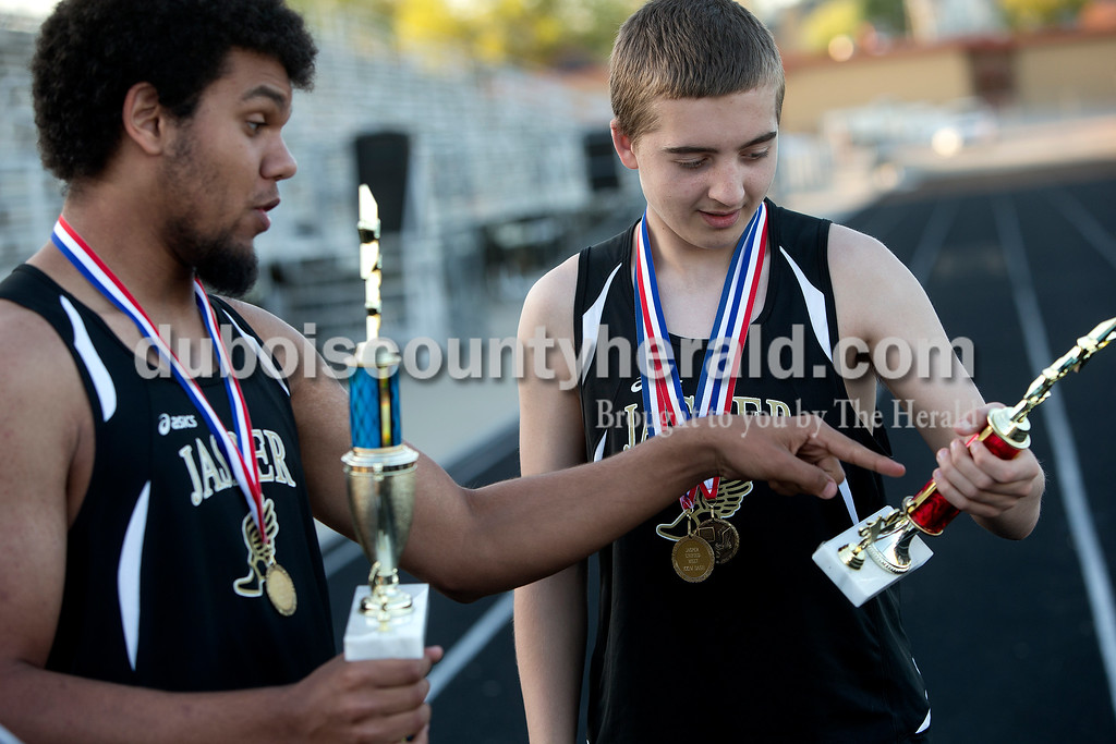 Jasper's Antwan Chatman, left, and Alex Britzman admired their trophies after Tuesday night's unified track meet against Boonville at Jerry Brewer Alumni Stadium in Jasper. Dave Weatherwax/The Herald