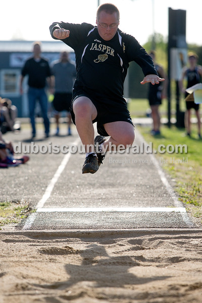 Jasper's Adam Schwartz competed in the long jump during Tuesday night's unified track meet against Boonville at Jerry Brewer Alumni Stadium in Jasper. Dave Weatherwax/The Herald