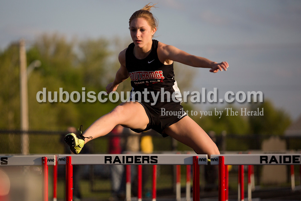 Southridge's Taylor Neukam ran the 100-meter hurdles during Thursday night's Southridge Invitational in Huntingburg. Southridge finished first (141), Heritage Hills finished second (137) and Northeast Dubois finished fourth (66) out of seven teams.