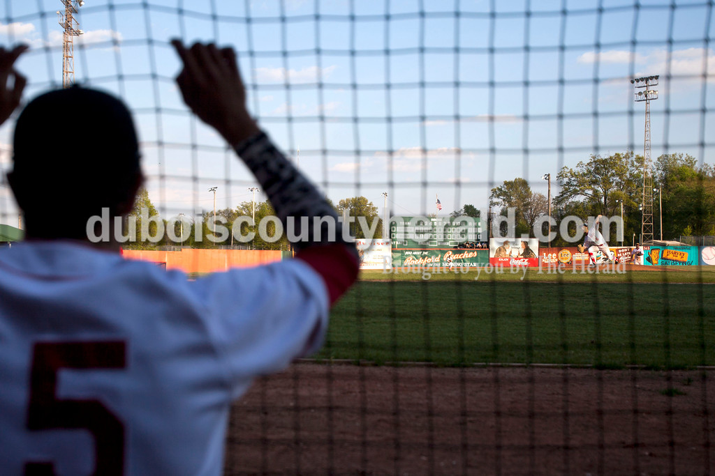 Southridge's Ross Eckert watched Luke Stetter pitch during Wednesday night's game against Tecumseh at League Stadium in Huntingburg. The Raiders won 6-1. <br /> Alisha Jucevic/The Herald