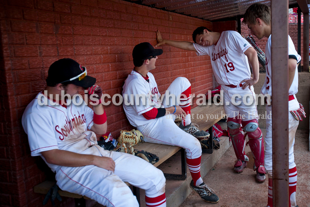 Southridge's Connor Craig, Payton Mattingly, Brett Nordhoff and Andrew Recker talked in the dugout in between innings during Wednesday night's game against Tecumseh against Tecumseh at League Stadium in Huntingburg. The Raiders won 6-1. <br /> Alisha Jucevic/The Herald