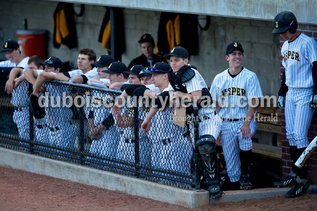 Jasper's Tyler Begle talked with Cal Krueger as the team watched the game from the dugout during Thursday night's game against Northeast Dubois at Ruxer Field in Jasper. Jasper won 21-0. <br /> Alisha Jucevic/The Herald