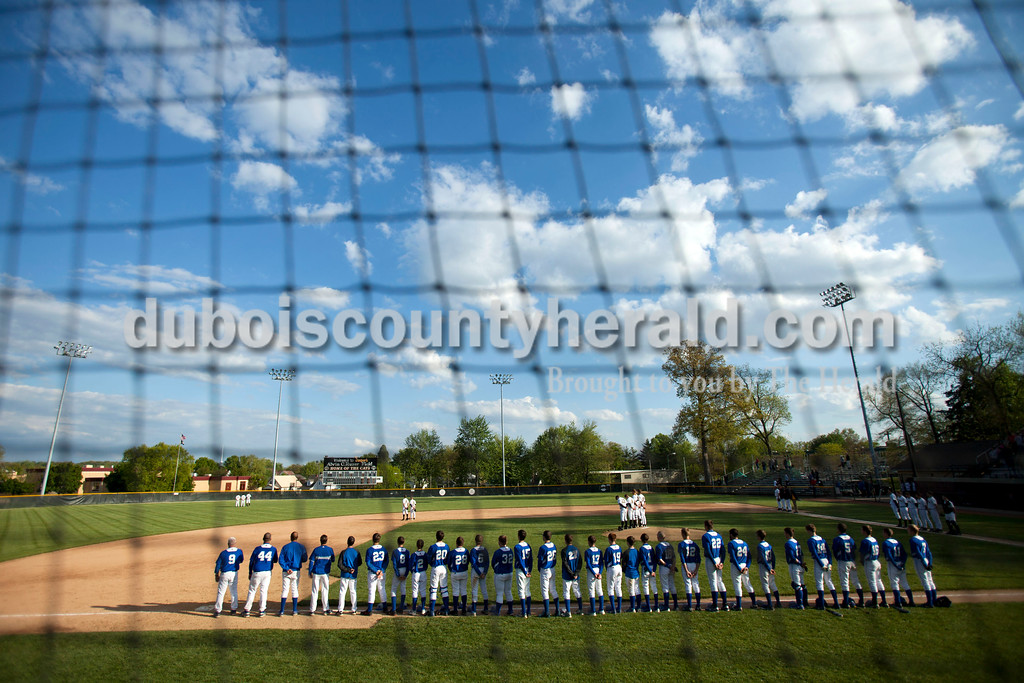 The Jasper and Northeast Dubois teams lined up on the field for the National Anthem before Thursday night's game at Ruxer Field in Jasper. Jasper won 21-0. <br /> Alisha Jucevic/The Herald