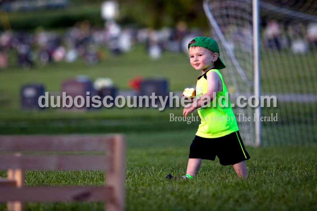 Jax Jacob of St. Anthony, 2, walked around the obstacle course during the 5K Fun Fest put on by Ferdinand Elementary School on Friday evening in Ferdinand. The festivities included a 5K run and walk, yoga, circuit training, a bouncy house and an obstacle course. <br /> Alisha Jucevic/The Herald