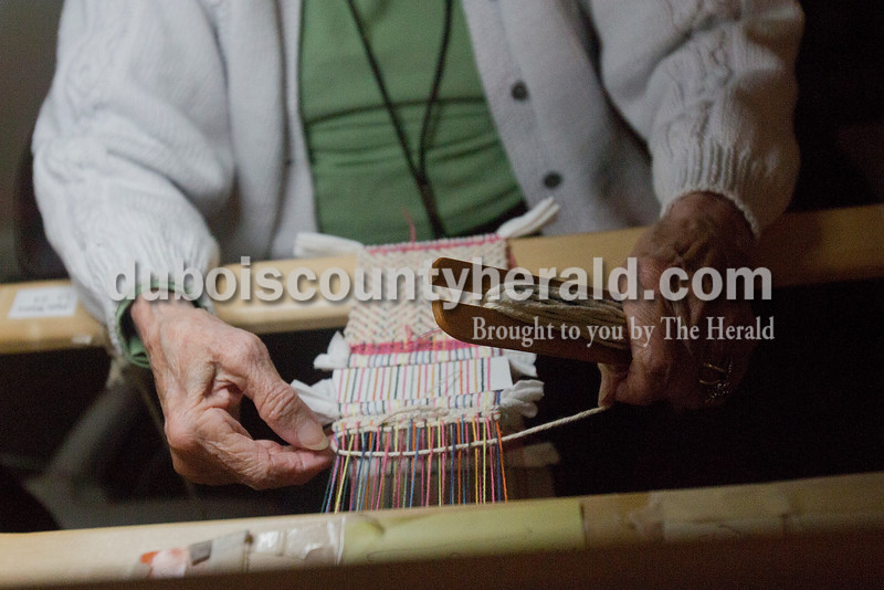 "Rachel Mummey/The Herald<br /> Brookside Village Senior Living Community resident Edna Overbeck wove ""mug rugs"" on Wednesday morning. Overbeck moved to the facility a little over a week ago and brought the knitting loom with her. She works on it every morning after breakfast."