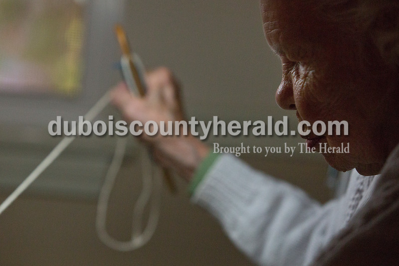 """Rachel Mummey/The Herald<br /> Brookside Village Senior Living Community resident Edna Overbeck wove """"mug rugs"""" on Wednesday morning. Overbeck moved to the facility a little over a week ago and brought the knitting loom with her. She works on it every morning after breakfast."""
