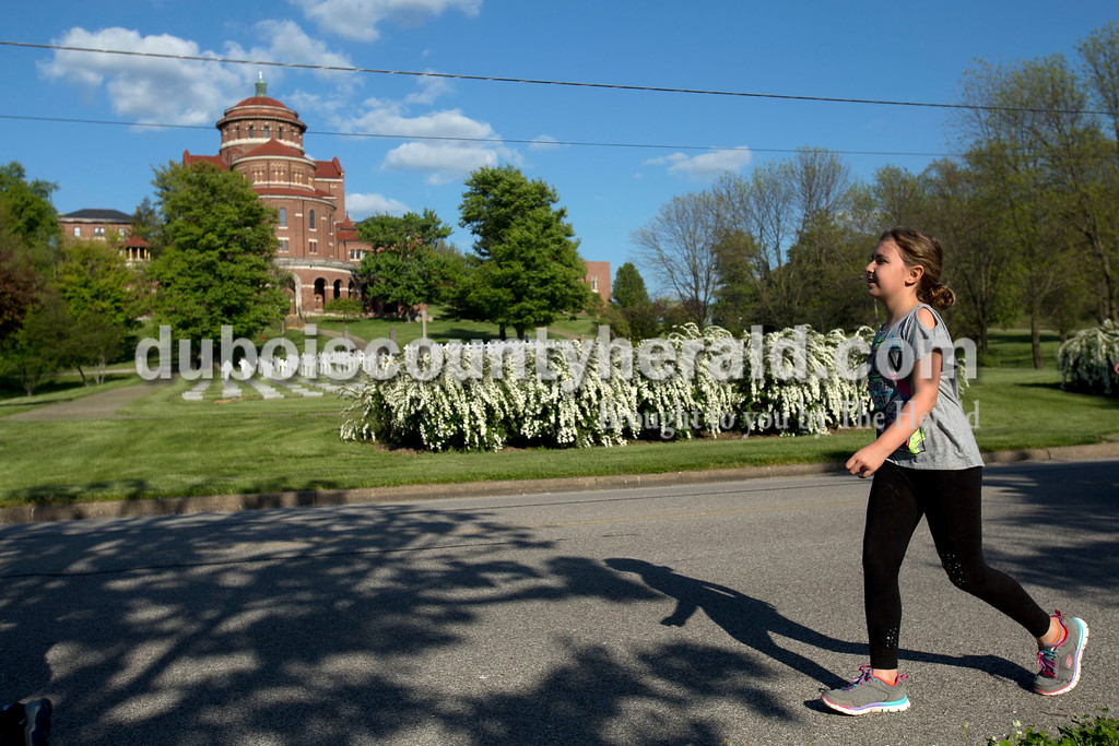 Ferdinand Elementary School third grader Kennedy Staton ran past the Monestary of Immaculate Conception during the 5K Fun Fest put on by Ferdinand Elementary School on Friday evening in Ferdinand. The festivities included a 5K run and walk, yoga, circuit training, a bouncy house and an obstacle course. <br /> <br /> Alisha Jucevic/The Herald