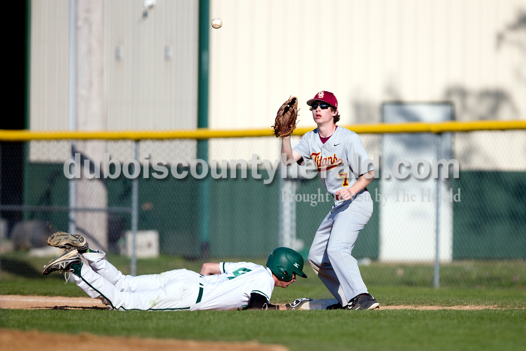 Forest Park's Jaxon Cronin slid back to first base as Gibson Southern's Jesse Reed tried to force an out during Friday evening's game in Ferdinand. The Rangers won 12-2 in six innings. Ariana van den Akker/The Herald