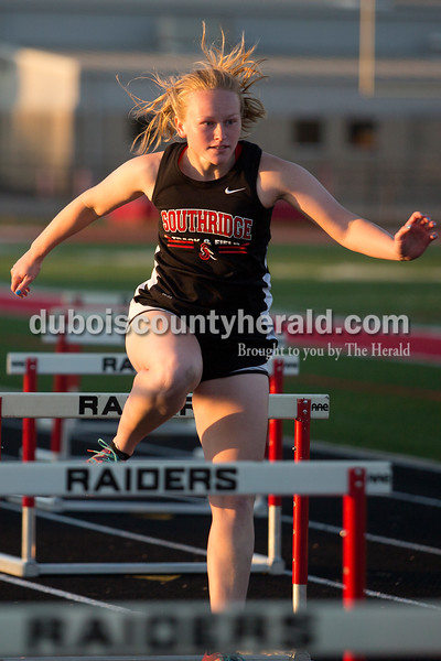Southridge's Sidney Eckert ran in the 300-meter hurdles during Thursday night's Southridge Invitational in Huntingburg. Southridge finished first (141), Heritage Hills finished second (137) and Northeast Dubois finished fourth (66) out of seven teams.