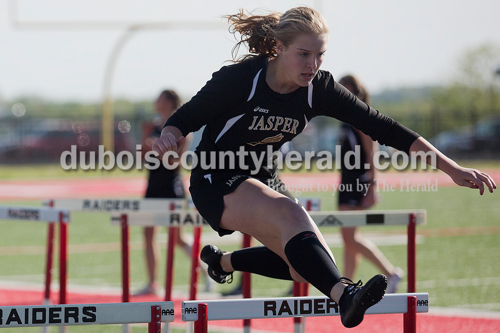 Jasper's Kirby Ruhe raced in the 300-meter hurdles during Monday's track meet against Southridge in Huntingburg. Jasper boys won 90-41, and Jasper girls won 84-53. Rachel Mummey/The Herald