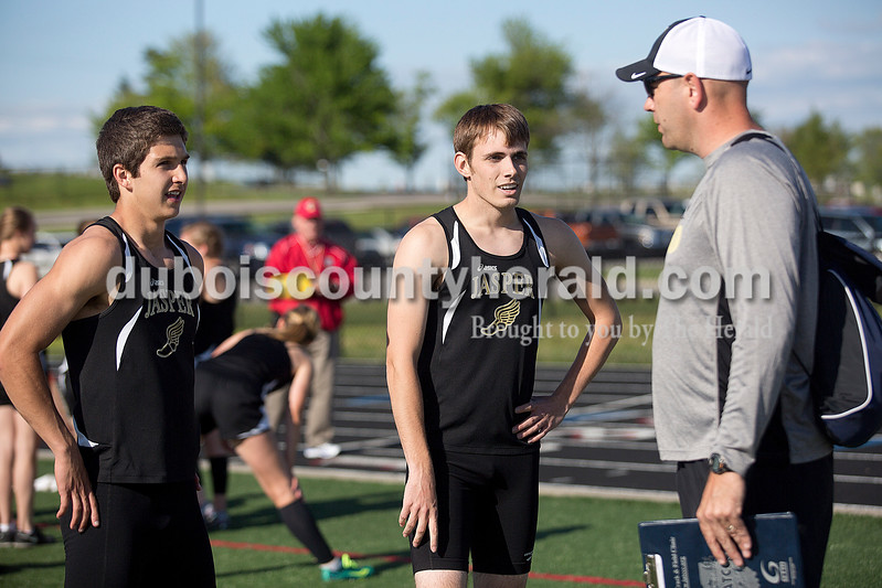 Jasper's Elliot Prange, left, and Reid Milligan talked with coach Kevin Schipp after their races during Monday's track meet against Southridge in Huntingburg. Jasper boys won 90-41, and Jasper girls won 84-53. Rachel Mummey/The Herald