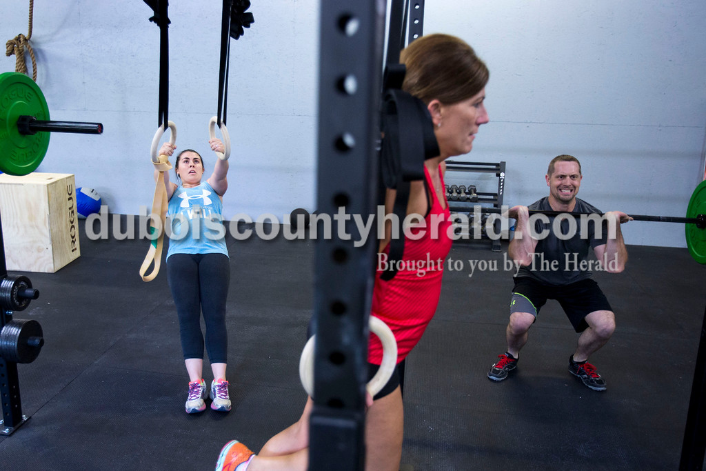 "Ashley Altmeyer, Jane Fritch and Brian Freyberger, all of Jasper, completed timed exercises at CrossFit Discipline on Tuesday evening in Jasper. Altmeyer and her mother, Jane Fritch, are taking the classes together. They worked hard in the class in preparation of Altmeyer's wedding this weekend. ""We're going to look good for the big day,"" said Fritch. <br /> <br /> Alisha Jucevic/The Herald"