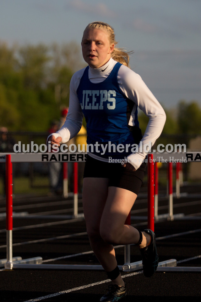 Northeast Dubois' Kelli Reutman ran in the 100-meter hurdles during Thursday night's Southridge Invitational in Huntingburg. Southridge finished first (141), Heritage Hills finished second (137) and Northeast Dubois finished fourth (66) out of seven teams.