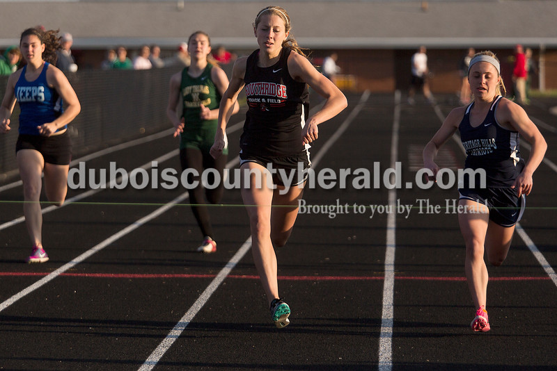 Southridge's Aubrey Main edged out Heritage Hills' Breigh Haase in the 100-meter dash during Thursday night's Southridge Invitational in Huntingburg. Southridge finished first (141), Heritage Hills finished second (137) and Northeast Dubois finished fourth (66) out of seven teams.