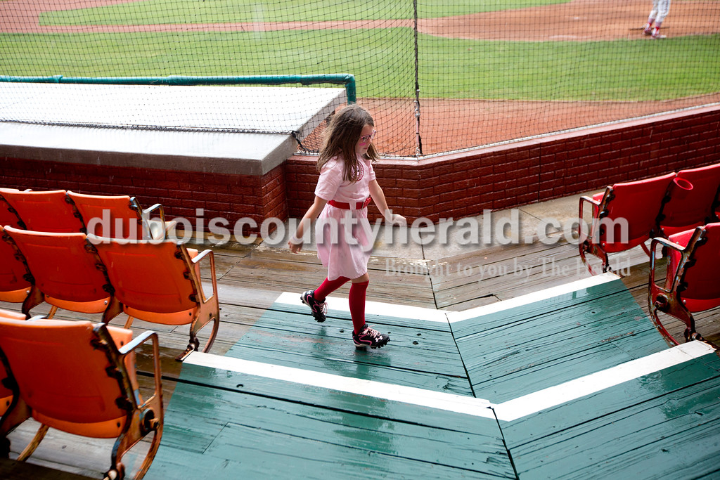 Ariana van den Akker/The Herald<br /> Riley Blessinger of Huntingburg, 6, danced around League Stadium before opening day for the Dubois County Bombers on Saturday in Huntingburg. Riley's parents had the Peaches costume made for her for Halloween last year. The Bombers played the Fulton Railroaders and lost 9-3.
