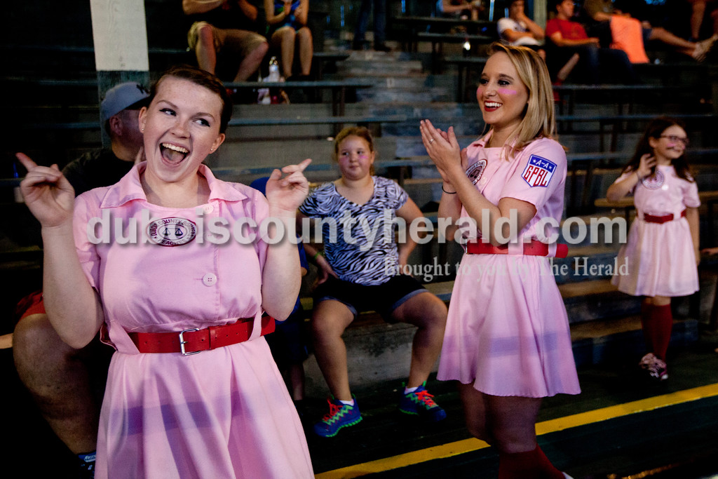 """Ariana van den Akker/The Herald<br /> Rockford Peaches Gabbi Skaggs of Ireland, left, and Jessica Oser of Huntingburg finished performing a dance to """"Cotton-Eyed Joe"""" in the middle of the fifth inning at opening day for the Dubois County Bombers on Saturday at League Stadium in Huntingburg. The Bombers played the Fulton Railroaders and lost 9-3."""