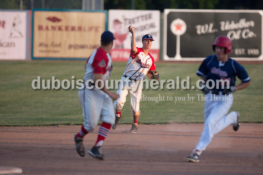 Dubois County Bombers' Jacob Snodgrass fielded a ground ball during Wednesday night's game against Owensboro Oilers at League Stadium in Huntingburg. The Bombers won 10-1. Rachel Mummey/The Herald