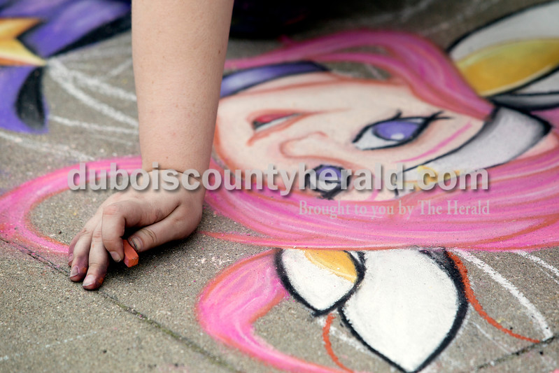 "Ariana van den Akker/The Herald<br /> Elizabeth Dunn of Jasper worked on her drawing of Star Guardian Lux from ""League of Legends"" during the 12th annual Chalk Walk Arts festival in downtown Jasper on Saturday."