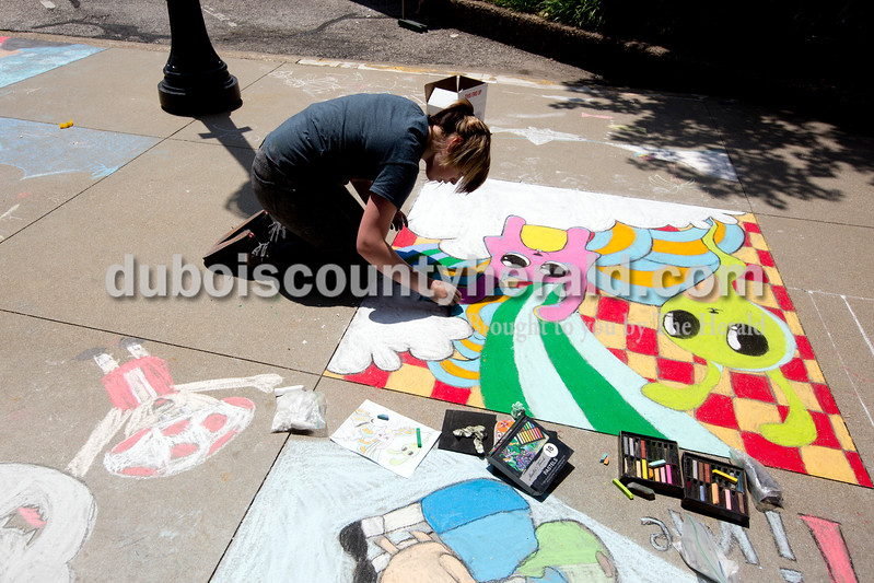 Ariana van den Akker/The Herald<br /> Bethany Myers of Leavenworth, 15, worked on her creation during the 12th annual Chalk Walk Arts festival in downtown Jasper on Saturday. This was Myers' first time at Chalk Walk.