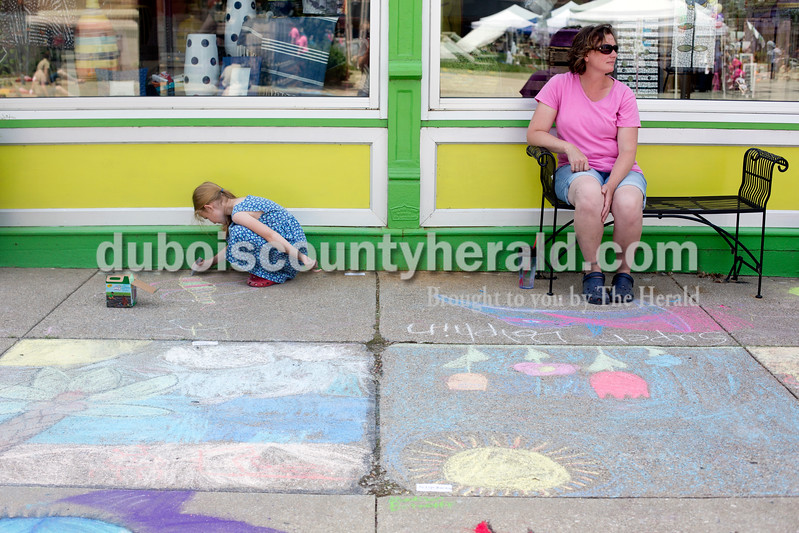 Ariana van den Akker/The Herald<br /> Jovie Huddleston of Jasper, 7, worked on her square as her mom Tammy took in the square during the 12th annual Chalk Walk Arts festival in downtown Jasper on Saturday.
