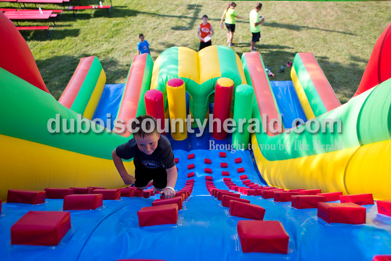 Jace Welch of New Boston, 5, raced up the blow up obstacle course during the St. Boniface Catholic Parish 150th anniversary celebration on Friday evening in Fulda. The weekend celebration festivities included live music, specialty food, children's games and a beer garden. <br /> <br /> Alisha Jucevic/The Herald