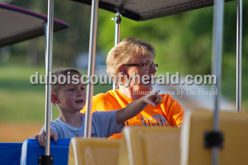 "Connie Betz of Schnellville rode the train with her grandson Cy Keller of Mariah Hill, 5, during the St. Boniface Catholic Parish 150th anniversary celebration on Friday evening in Fulda. ""He was showing grandma all the sights,"" said Betz. The weekend celebration festivities included live music, specialty food, children's games and a beer garden. <br /> <br /> Alisha Jucevic/The Herald"