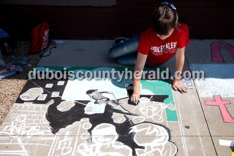 "Ariana van den Akker/The Herald<br /> Charity Carkuff of Leavenworth, 16, drew a scene from ""Teenage Mutant Ninja Turtles"" during the 12th annual Chalk Walk Arts festival in downtown Jasper on Saturday."