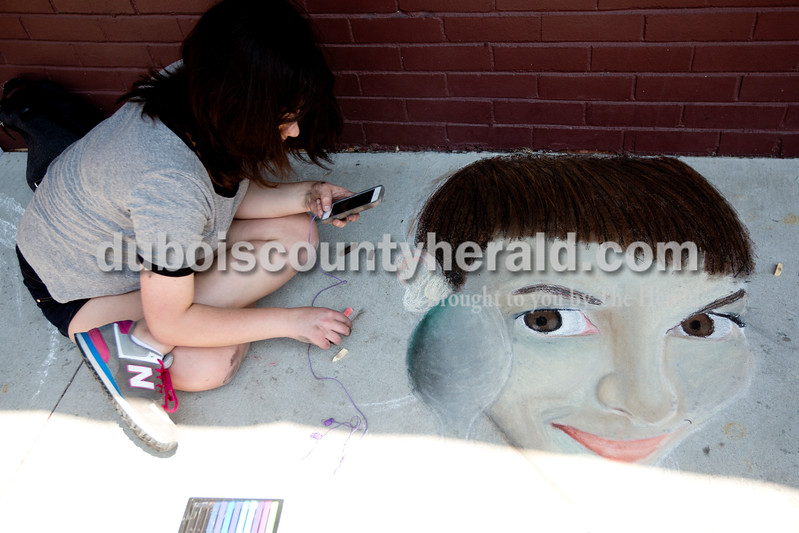 "Ariana van den Akker/The Herald<br /> Hilary Bauer of Jasper, 16, drew a scene from the movie ""Amelie"" during the 12th annual Chalk Walk Arts festival in downtown Jasper on Saturday."