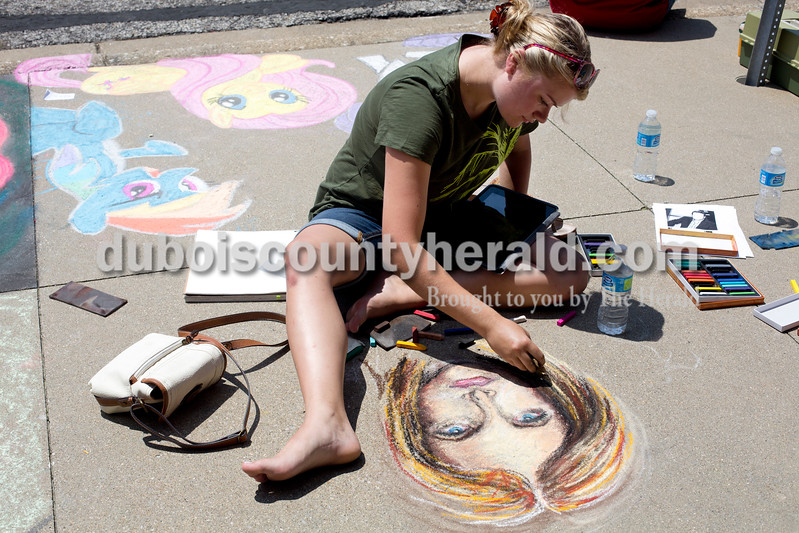 "Ariana van den Akker/The Herald<br /> Reagan Moorman of Jasper worked on a drawing of ""Buffy the Vampire Slayer"" during the 12th annual Chalk Walk Arts festival in downtown Jasper on Saturday."