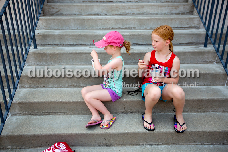 Ariana van den Akker/The Herald<br /> Katelyn Young of Jasper, 5, left, and her sister Olivia slurped slushies during the 12th annual Chalk Walk Arts festival in downtown Jasper on Saturday.