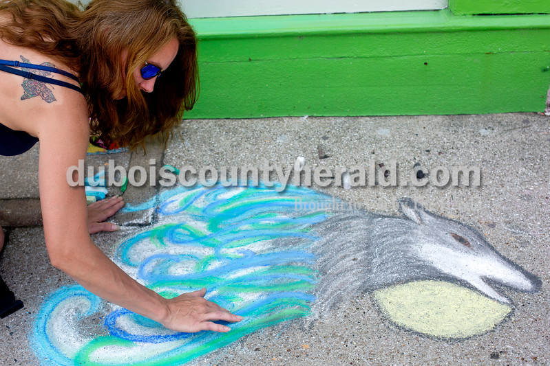 Ariana van den Akker/The Herald<br /> Michelle Dunn of Jasper blended the swirls on her drawing of a wolf during the 12th annual Chalk Walk Arts festival in downtown Jasper on Saturday.