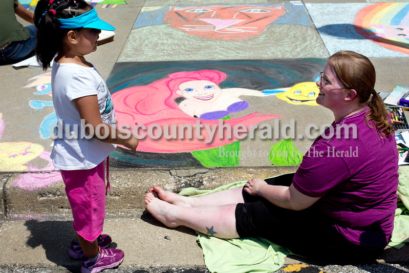 "Ariana van den Akker/The Herald<br /> Katie Flores of Jasper, 4, left, and Katie Morgan of Huntingburg talked about Morgan's ""Little Mermaid"" drawing during the 12th annual Chalk Walk Arts festival in downtown Jasper on Saturday. Morgan said that she likes to draw characters from children's movies for Chalk Walk because kids get really excited about them."