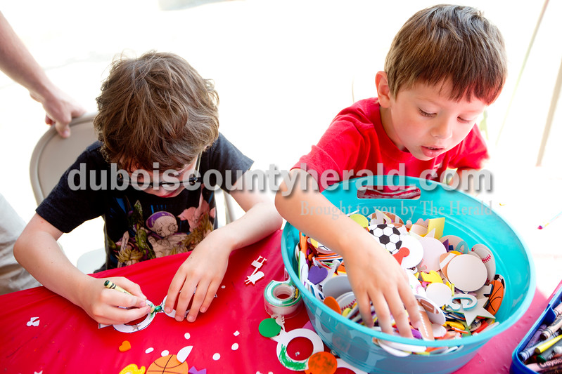Ariana van den Akker/The Herald<br /> Logan Wood of Jasper, 8, left, and his brother Jack, 5, make masks during the 12th annual Chalk Walk Arts festival in downtown Jasper on Saturday.