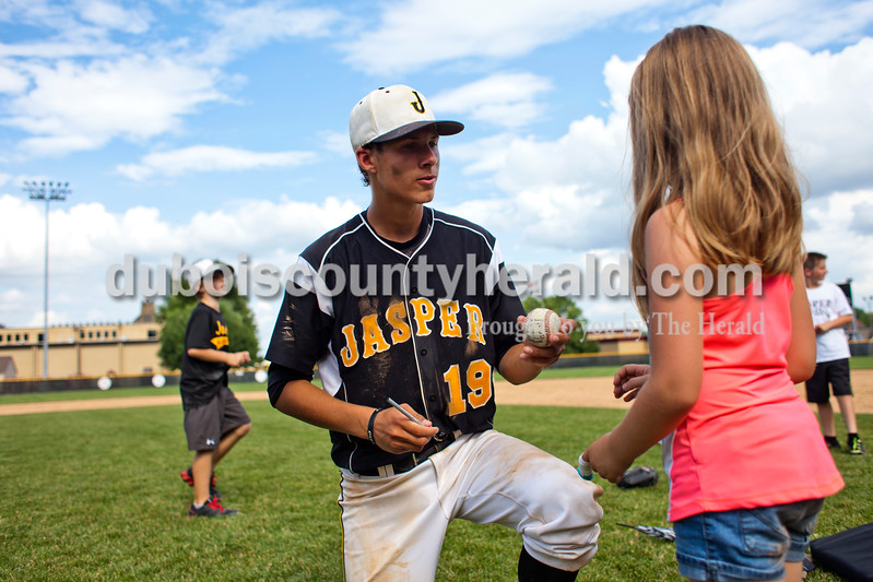 Jasper's Evan Aders signed a baseball for Jaida Kendall of Jasper, 7, after Saturday's Class 3A semistate championship against West Vigo at Ruxer Field in Jasper. The Wildcats won 6-0. <br /> <br /> Alisha Jucevic/The Herald