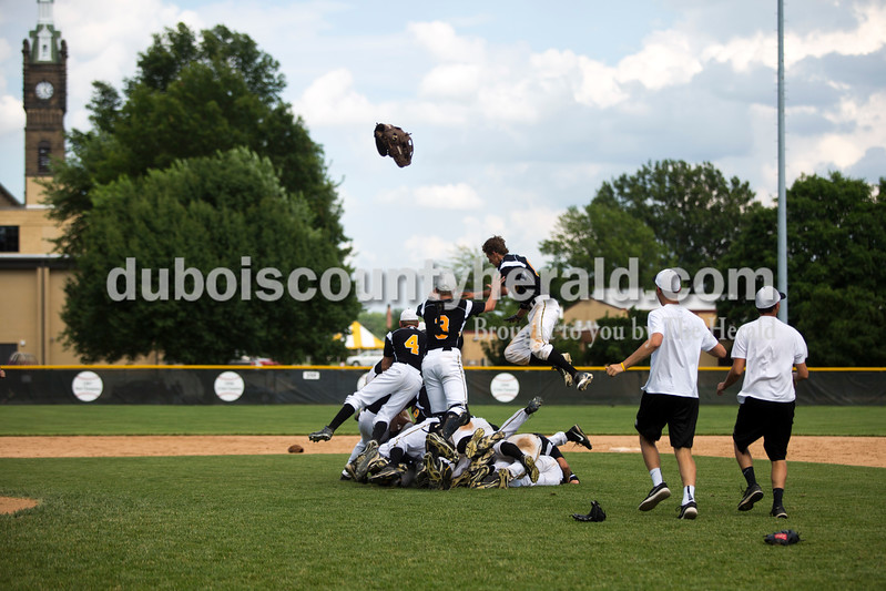 The Wildcats jumped into a pile in celebration after winning Saturday's Class 3A semistate championship against West Vigo at Ruxer Field in Jasper. The Wildcats won 6-0. <br /> <br /> Alisha Jucevic/The Herald