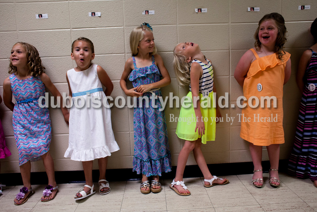 Kenley Frick, 5, Alexa Tyree, 5, Riley Hinson, 7, Kenley Schipp, 5, and Alivia Hoppenjans, 5, all of Ferdinand, stood in line as they waited for the Little Miss and Mister Pageant to begin on Sunday afternoon at Forest Park High School in Ferdinand. <br /> <br /> Alisha Jucevic/The Herald