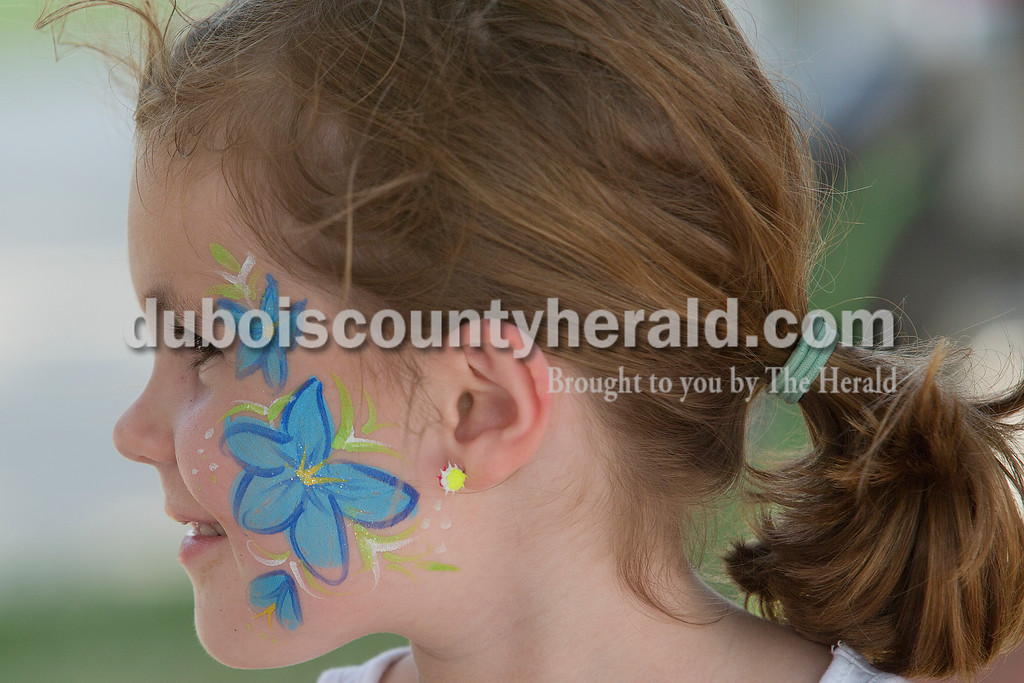 Phoebe Hollinden of St. Henry, 5, showed off her freshly painted face during the Heinrichsdorf's Fest in St. Henry on Friday. Rachel Mummey/The Herald