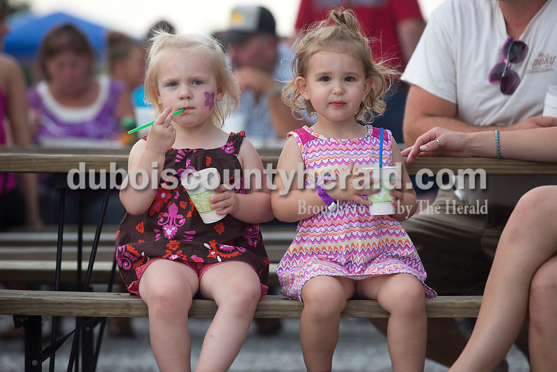 Tatum Schwoeppe, left, and Amelia Oeding, both 2 and of St. Henry, enjoyed slushies during the Heinrichsdorf's Fest in St. Henry on Friday. Rachel Mummey/The Herald
