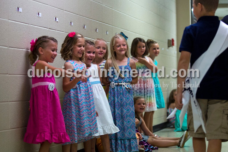 Leah Tyree, 5, Kenley Frick, 5, Alexa Tyree, 5, Kenley Schipp, 5, and Riley Hinson, 7, all of Ferdinand, watched as the 2014 Little Mister Heimatfest, Leo Widolff, walked past them on Sunday afternoon at the Ferdinand 175th Little Miss and Mister Pageant at Forest Park High School in Ferdinand. <br /> <br /> Alisha Jucevic/The Herald