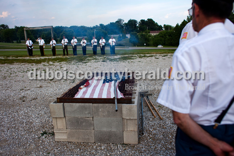 "Dubois County veterans gathered on Friday evening for an official flag burning ceremony at  4-H Fairgrounds in Jasper. According to the Patriotic Customs section of the U.S. Code, ""The flag, when it is in such condition that it is no longer a fitting emblem for display, should be destroyed in a dignified way, preferably by burning."" <br /> <br /> Alisha Jucevic/The Herald"