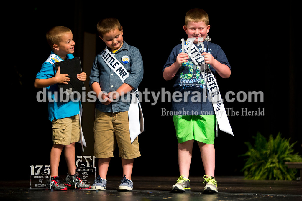 Little Mister Photogenic and second runner-up Layton Lubbehusen, 6, Little Mister first runner-up Lance Boeglin, 6, and Little Mister Ferdinand 175 Logan Fischer, 7, all of Ferdinand, stood on stage on Sunday afternoon at the Ferdinand 175 Little Miss and Mister Pageant in the auditorium at Forest Park High School in Ferdinand. <br /> <br /> Alisha Jucevic/The Herald