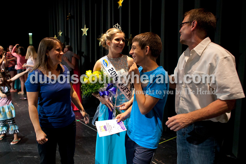 Miss Ferdinand 175 Kayla Hoffman stood with her parents, Carla Stillwell and Kevin Hoffman and her brother Zach Hoffman, 15, after the Ferdinand 175th Queen Pageant on Sunday evening in the auditorium at Forest Park High School in Ferdinand. <br /> <br /> Alisha Jucevic/The Herald
