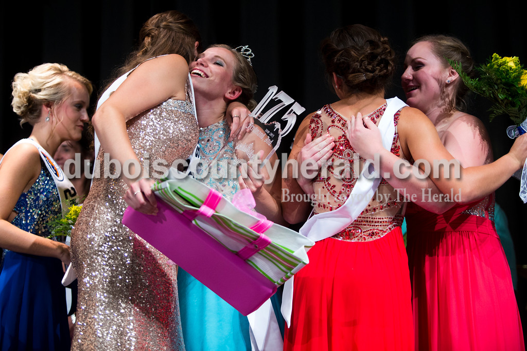 Miss Congeniality Claire Mohr, 18, embraced Miss Ferdinand 175th Kayla Hoffman, 18, and first runner-up Lauren Tretter embraced Mackenzie Voegerl, 16, all of Ferdinand, after the Ferdinand 175th Queen Pageant on Sunday evening in the auditorium at Forest Park High School in Ferdinand. <br /> <br /> Alisha Jucevic/The Herald
