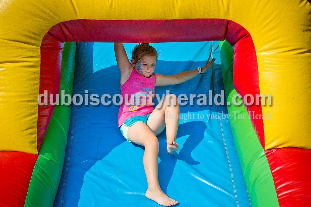 Lyndsey Taylor of St. Henry, 7, slid down an inflatable slide during the Heinrichsdorf's Fest in St. Henry on Friday. Rachel Mummey/The Herald