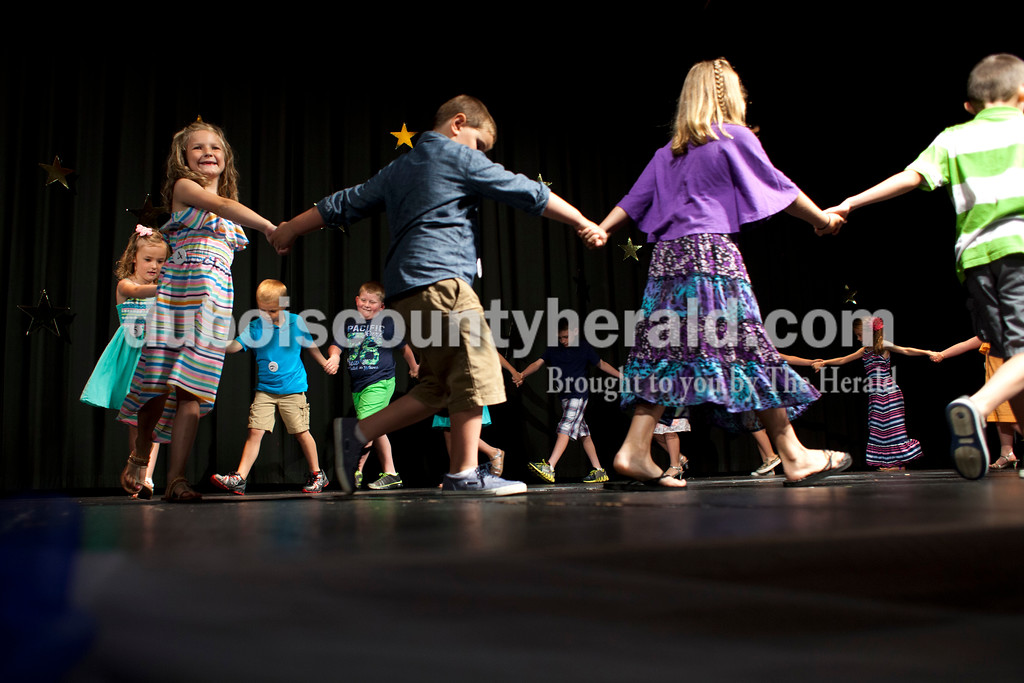Little Miss Ferdinand 175 Bailey Anderson, 7, smiled out at the crowd as the Little Miss and Little Mister contestants performed a dance on Sunday afternoon at the Ferdinand 175th Little Miss and Mister Pageant in the auditorium at Forest Park High School in Ferdinand. <br /> <br /> Alisha Jucevic/The Herald